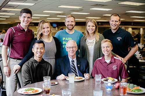 Students visit with President Jerry C. Davis in the Pearl Rogers Dining Hall
