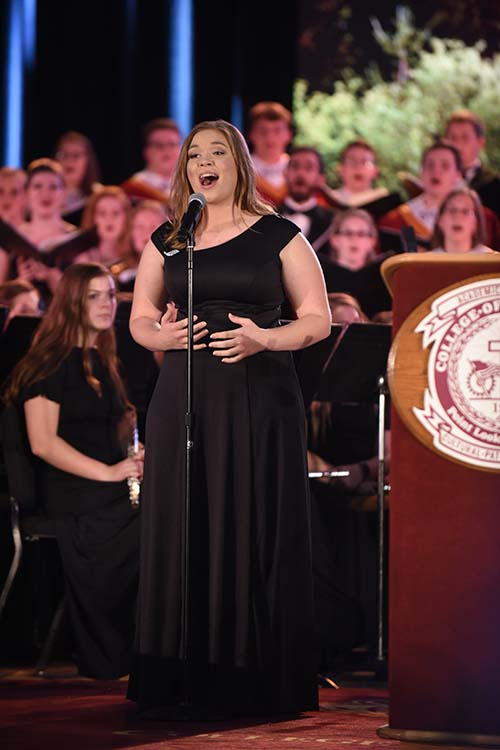 Junior music ministry major Ashley Mattingly sings a solo at the Leonard B. and Edith Gittinger Community Convocation before Sarah Huckabee Sanders' keynote address. (Photo by Larry Plumlee)