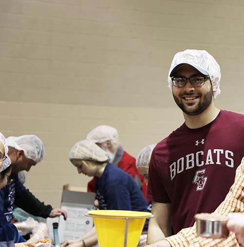 Ben Lunsford, junior business administration major and speech communication minor at College of the Ozarks, volunteered to help package meals.