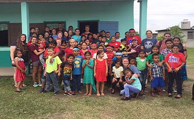 Students, faculty, and staff from College of the Ozarks teach lessons at the Billy White Primary School of San Ignacio, Belize.