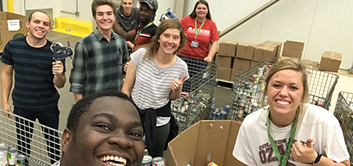 College students associated with Work Colleges Consortium organize and prepared canned goods for hurricane victims as service project.