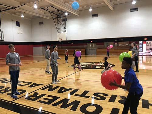 S of O students play basketball with children on mission trip