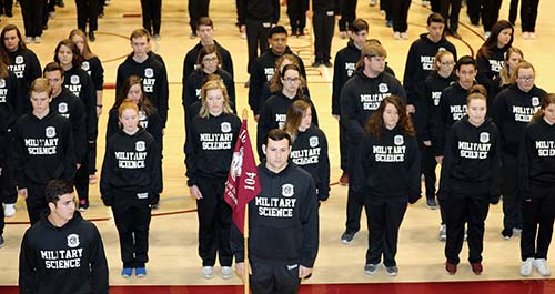 Students rehearse marching and staying at attention.
