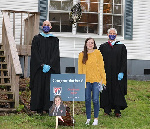 Senior Kara Bergeron celebrates with greetings by school administrators – (L) Scott McElvain, assistant to the dean, and (R) Brad Dolloff, dean of School of the Ozarks.
