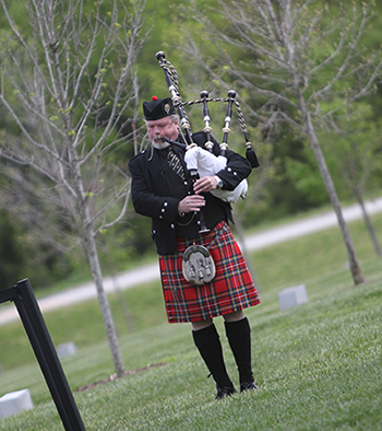 Bagpiper plays Amazing Grace