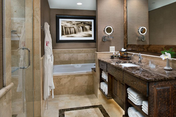 Bath features jetted tub and separate shower.