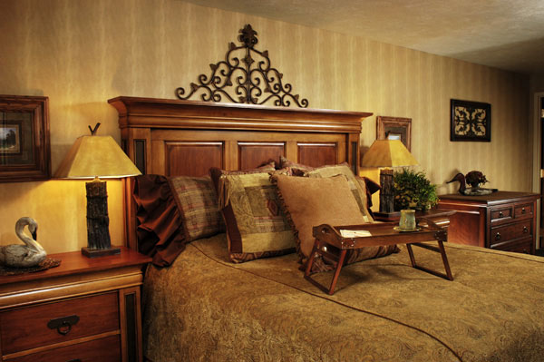 A cleanly made bed flanked by 