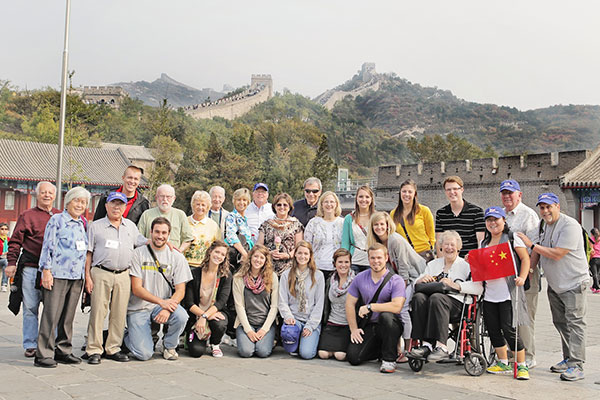 students and sponsors with great wall in background