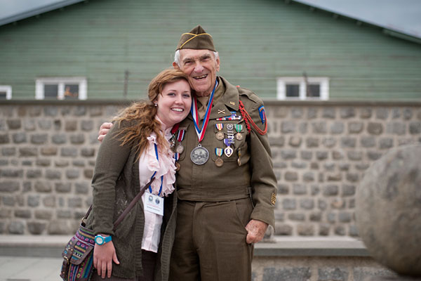 a student and Veteran pose for picture