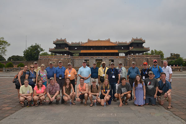students, Veterans and sponsor in front of Royal palace inside citadel in Hue, central Vietnam