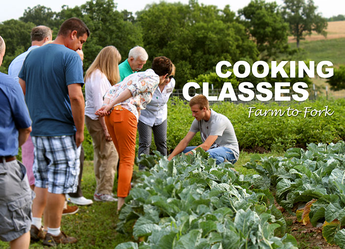 C of O student gives cooking school attendees a tour of the gardens