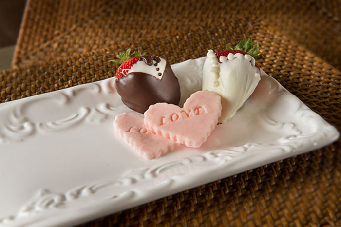 Chocolate covered strawberries and heart shaped candies