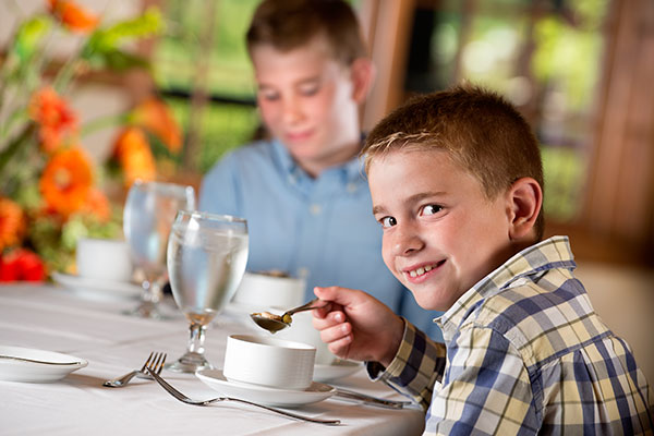 Young boy at etiquette classes in Branson