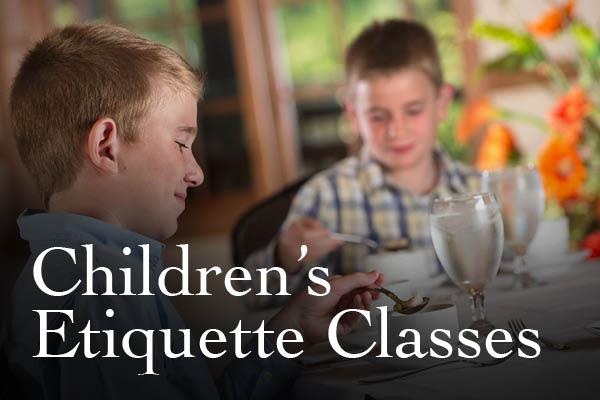 Well dressed children enjoying the etiquette class.