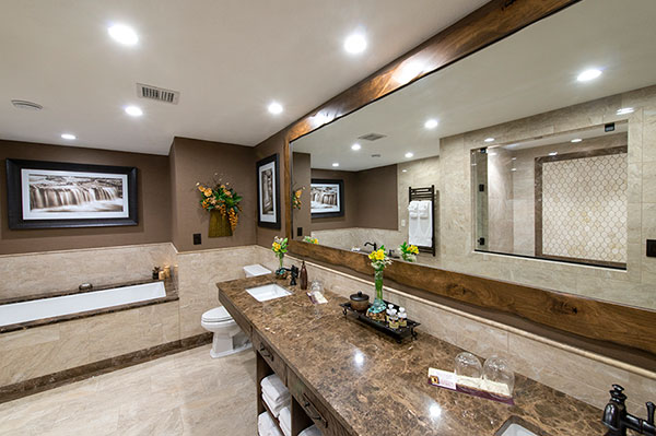 Jacuzzi bathtub and double vanity at a luxury hotel in Branson MO