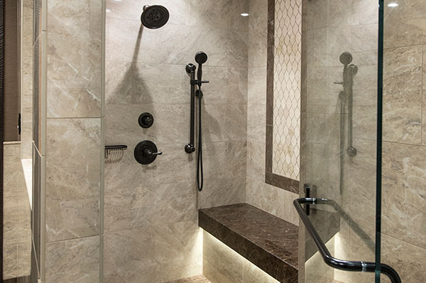 Luxury tiled shower with bench seat at the Presidential Suite in Branson MO